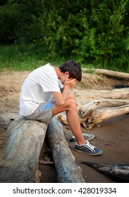 Sad Young Man on the Nature Background