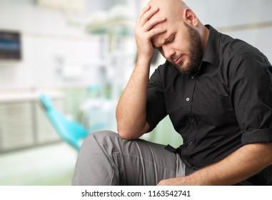 Sad young man sitting