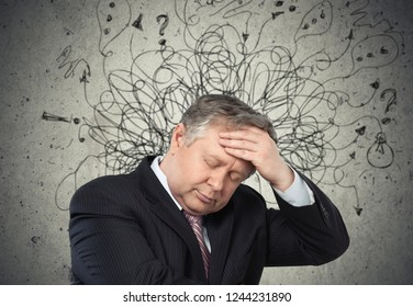 Sad young man with worried stressed face expression and brain melting into lines question marks. Obsessive compulsive, adhd, anxiety disorders concept