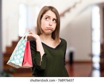 sad young pretty woman with shopping bags