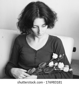 sad young woman with flowers