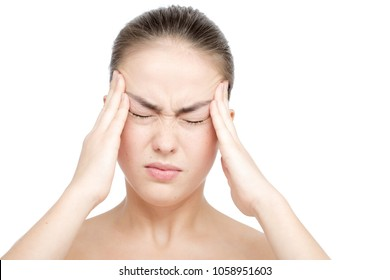 sad young woman with headache touching her head, isolated on white