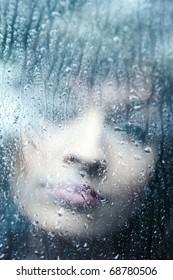 Sad young woman and a rain drops