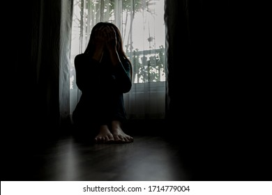 Sad young woman sitting in the bedroom, People with depression concept.