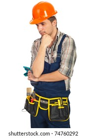 Sad young workman looking down and thinking isolated on white background