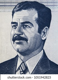 Saddam Hussein face portrait on Iraqi 100 dinar (2002) banknote closeup, leader and president of Iraq.