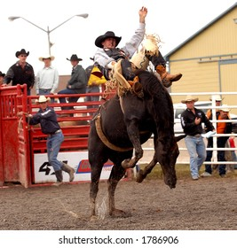 Saddle Bronc riding at the Help A Child Smile Rodeo Sept. 3/2006 in Welland, Ontario, Canada