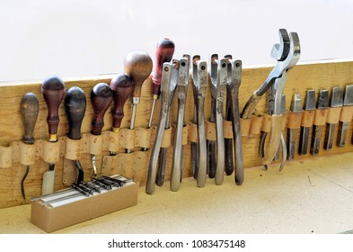 Saddle making. Tools used in leather saddle making.
