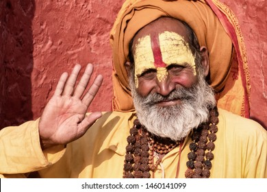 Sadhu man with traditional painted face in Pashupatinath Temple of Kathmandu, Nepal.Sadhu man refer to holy person.Nepal text in photo refer to prayer word om mani padme hum - Film grain effect