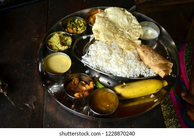 Sadhya dishes laid out in an authentic  traditional thali, the way Malayalis have it during Onam in Varkala, Kerala, India