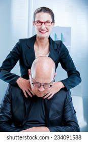 sadistic businesswoman happily thinking she is going to kill his colleague or torture him maybe as a revenge