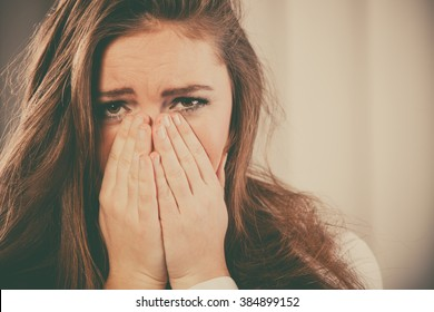 Sadness and emotional distress. Stressful situation in work trouble and anxiety. Young woman in white shirt cry.