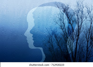 Sadness in Life Concept, Present by Shape of Man and Woman combined with Old Dry Tree and Rain, Blue Filter Effect