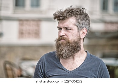 Sadness and problems concept. Man with beard and mustache looks not fresh. Bearded man on strict face looks sad and troubled, suffers from problems. Hipster with beard looks unhealthy.