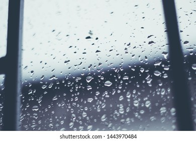 Sadness Rain drop on glass window. Abstract rain drop/raining scenery background. Concept of spring weather. Drama Sad Concept.