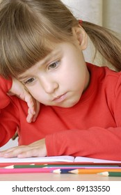 sadness schoolgirl portrait thinking and studding.