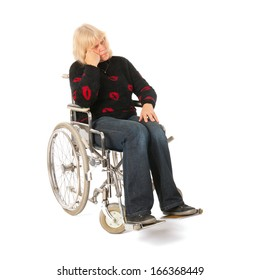 Sadness woman of mature age in wheel chair isolated over white background