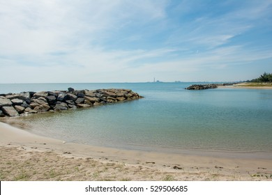 Saeng Chan Beach, Rayong, Thailand, is a series of man-made lagoon-type harbors with sandy coves of soft white sand. The small bays offer protection against erosion of the long beach and fishing boats
