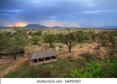 A safari camp in the serengeti as a storm moves in
