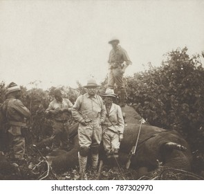 Safari group stands around a bull elephant Theodore Roosevelt shot at Meru, Kenya. TR stands in center, his son Kermit leans against the dead beast, and R. J. Cunninghame stands on it. Smithsonian-Roo