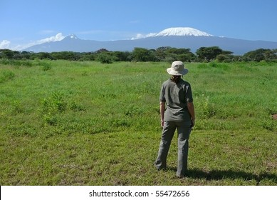 Safari traveler looks at the Kilimanjaro in Kenya