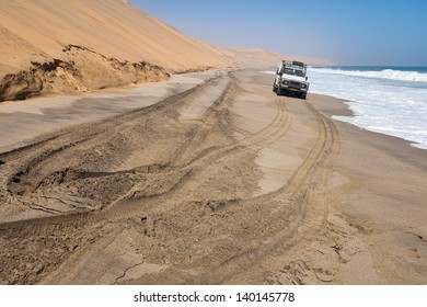 Safari trip alongside dunes and sea in Namibia
