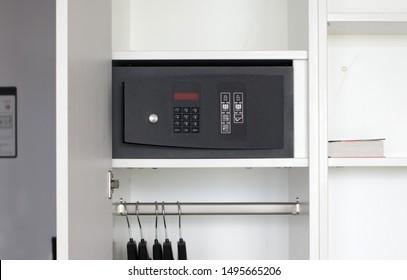 Safe box in a hotel room, white closet