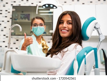 Its safe to go to the dentist in Coronavirus pandemics. Dentist showing thumbs up, while wearing surgical mask for protection.