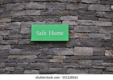 Safe Home Sign at Cliffs of Moher, County Clare - Ireland - on a Rock Wall