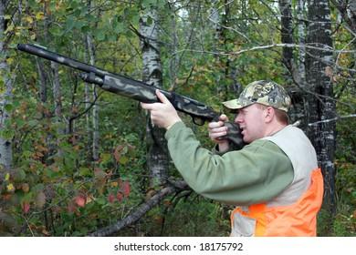 safe hunter wearing an orange vest