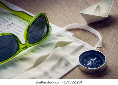 Safe Travel, mask and compass with green sunglasses and calendar