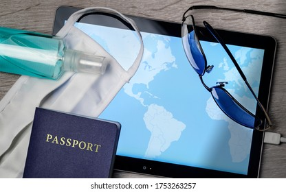 safe traveling during a pandemic crisis, topview with mask, map and other accesories