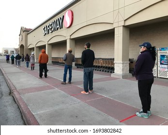 The safe way to go grocery shopping during the COVID-19 pandemic.  The line at Safeway at 7:00 AM 3 April 2020, Gallup New Mexico.