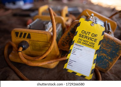 Safe workplace yellow out of service tag placing on RCD residual current devices as faulty damage equipment dangerous to used remove from services