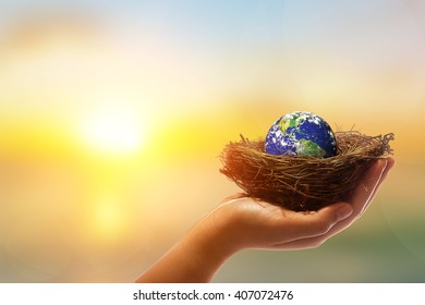 Safe world concept . Hand holding the world ball  on pastel background.Copy Space on horizontal sheet.Clipping path.Elements of this image furnished by NASA