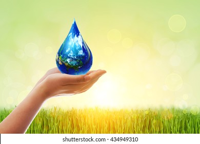 Safe world concept. Two Hands Wait for the world in water droplet shape on green bokeh background .Elements of this image furnished by NASA.United Nations Climate Change Conference.World Water Day