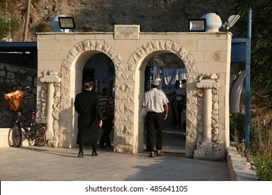 Safed, Israel -12 July 2015: Orthodox Jews on their way to Harry's mikvah  in The ancient old cemetary of Safed, in which many saintly Rabbis and righteous men spanning generations are burried.