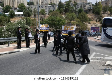SAFED, ISRAEL - AUG 2, 2018: Unidentified ultra orthodox Jewish men protest the arrest of a fellow Yeshiva student for not serving in the army and block traffic near the entrance of Safed, Israel