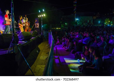 SAFED, ISRAEL - AUG 23, 2017: Group of musicians (Gute Gute) and crowd at the Klezmer Festival in Safed (Tzfat), Israel. Its the 30th annual traditional Jewish festival in the public streets of Safed