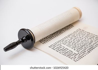 SAFED, ISRAEL - FEB 10, 2018: Open Megillat Esther (Book of Esther) isolated scroll on white backround. Read on the Jewish holiday of Purim.