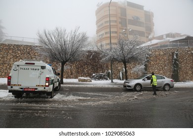 SAFED, ISRAEL - JAN 26, 2018: Police trucks and first responders on the scene at the clean up after a snow storm in Safed, Israel