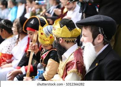 SAFED, ISRAEL - Mar 10, 2017: Dressed up Jewish school children gather and sit in crowd during the Chabad schools' annual Purim event