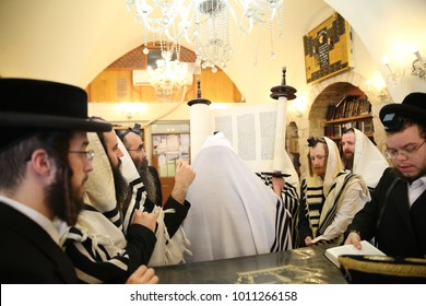 SAFED, ISRAEL - Nov 30, 2017: Rachmastrivka Rebbe reads from the Torah scroll and prays the morning prayer of Shacharit in a synagogue in Safed/Tzfat