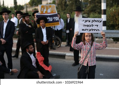 SAFED, ISRAEL -OCT 19, 2017: Ultra orthodox Jewish men protest for the release of a religious Jewish youth who was jailed for refusing to serve in the military, at the street entrance to Safed, Israel