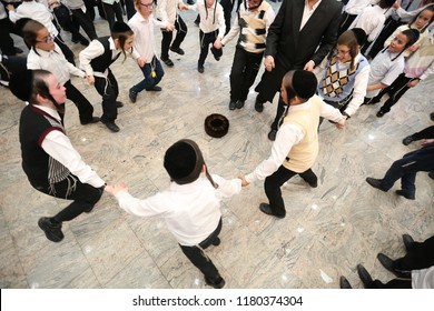 SAFED, ISRAEL  - OCT 8, 2017: Unidentified Jewish men and boys take part in a grand party in honor of the Jewish holiday of Sukkot in the Breslov Yeshiva School in Safed, Israel