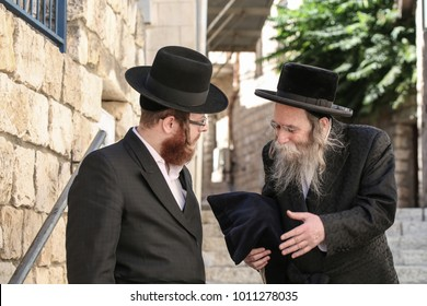 SAFED, ISRAEL - Sep 8, 2017: Erlau Rebbe (grand Rabbi) walks through the Old City of Safed/Tzfat with Hasidim (followers)