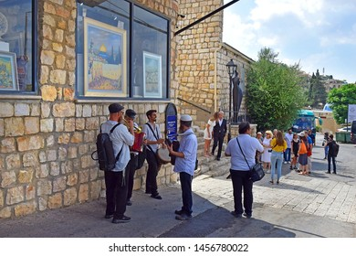 Safed, Upper Galilee, Israel - July 19, 2019: quartet of religious musicians, playing music on the old street in the quarter of artists in the old town of Safed , whose history spans 700 years