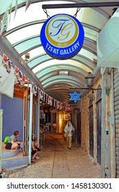 Safed, Upper Galilee, Israel - July 19, 2019: one of the narrow streets in the artists colony of Old Town. Safed is center of kabbalah and jewish mysticism in Israel