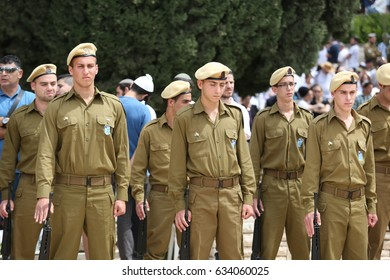 Safed,Israel May 1,2017 Israeli soldiers stand guard during a ceremony at the cemetery ,as Israel mark Memorial Day,commemorating the deaths of Israeli soldiers killed,and Israeli victims of terror