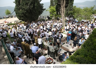 Safed,Israel-May 1,2017 Family members and Israeli soldiers visit at the cemetery,as Israel mark Memorial Day,commemorating the deaths of Israeli soldiers killed in wars,and Israeli victims of terror.